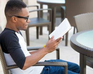 man reading book for financial advisors