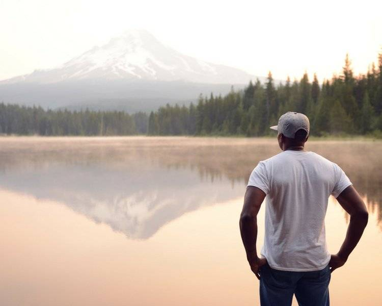 image of man staring at lake for blog post Mindfulness and Feedback: An Entrepreneurial Advisor's Best Friends